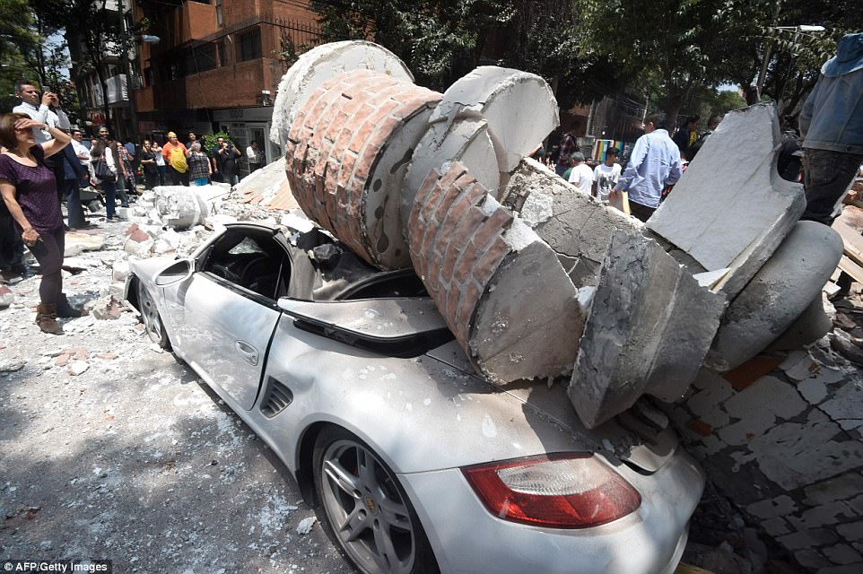 This car was left crushed under falling debris during the 7.1-magnitude earthquake
