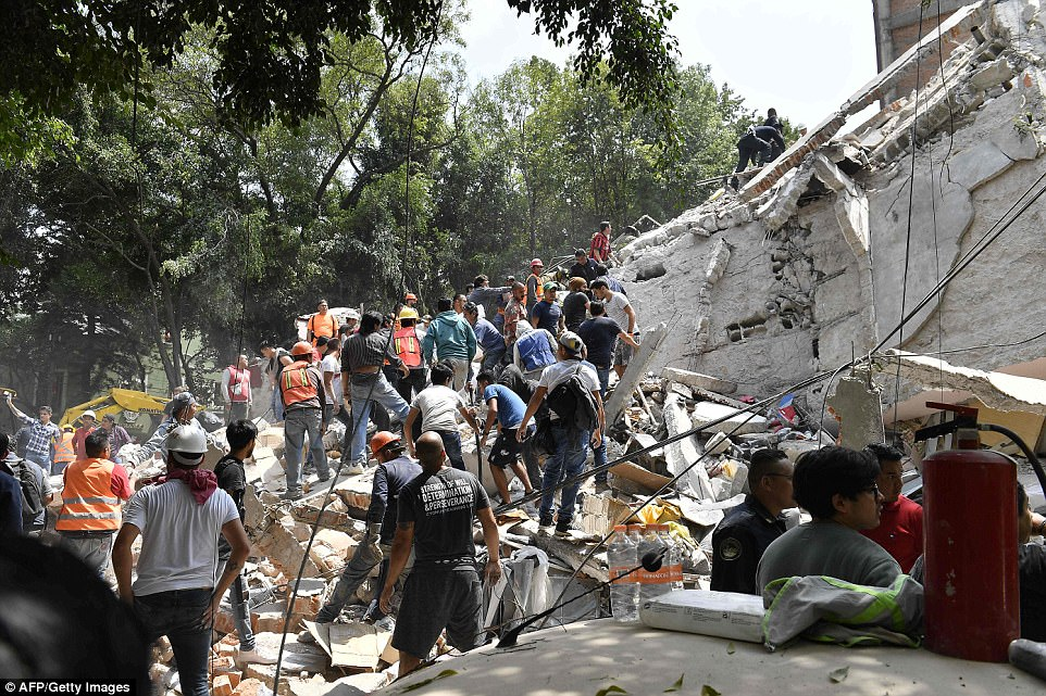 Horrifying images coming out of the country's capital show rubble strewn across roads and enormous chunks of collapsed buildings laying on the ground with hundreds of terrified locals fleeing onto the streets