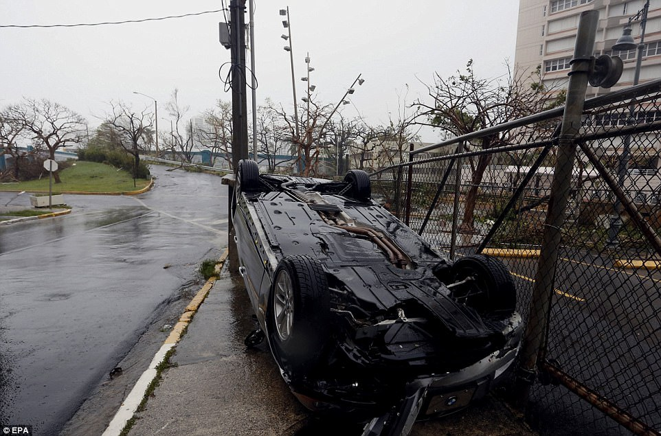 A car is seen flipped over in the aftermath of Hurricane Maria in San Juan, Puerto Rico on Wednesday
