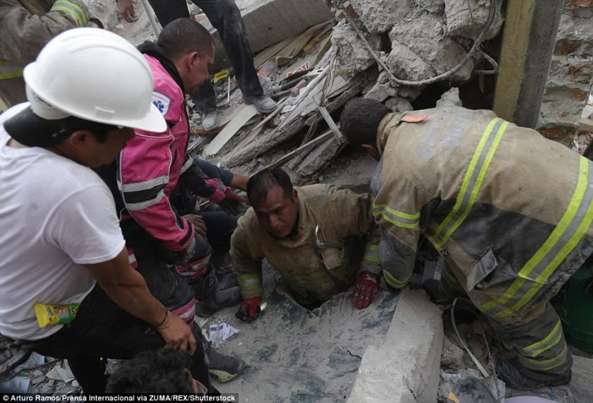 A person is rescued from the debris in Mexico City after the devastating earthquake on Wednesday that killed more than 230 people