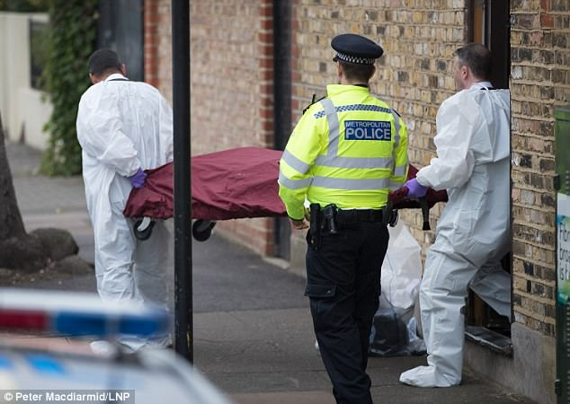 A body bag was driven from the scene in a private ambulance, while forensics officers continued their work