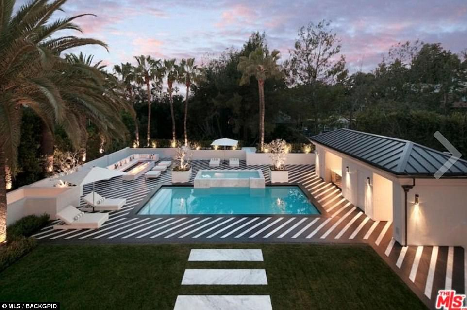 A general view of the outside of the Beverly Hills mansion, which has an outdoor swimming pool and a vast area for relaxing