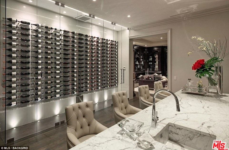The unbeaten 40-year-old has been showing off the mansion's glass-fronted wine collection to his followers on Instagram