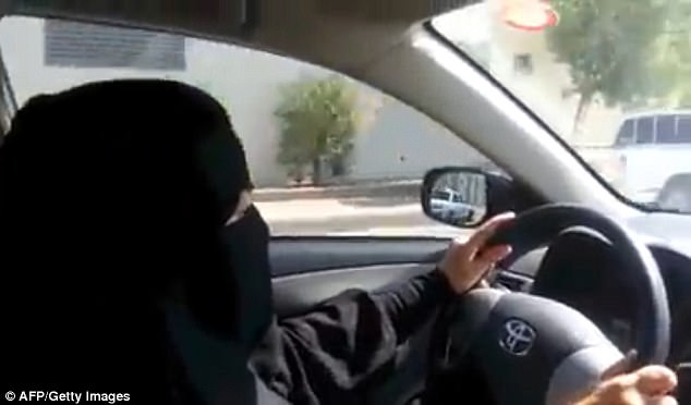 It comes after years of campaigning from within Saudi by rights activists. Pictured is one woman driving on the streets of Riyadh in 2013 on a day of action against the ban