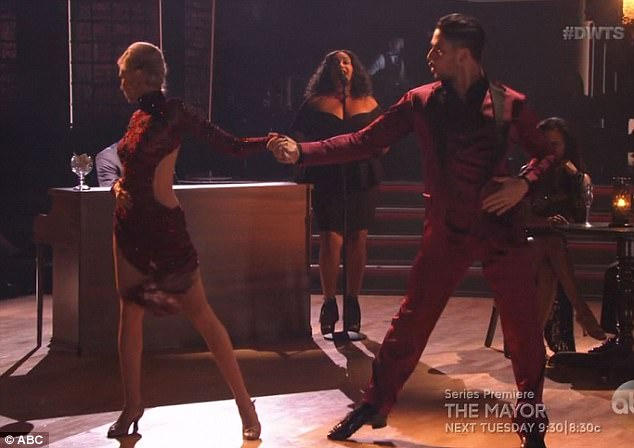 Tango time: Debbie sizzled in red while dancing a tango with Alan