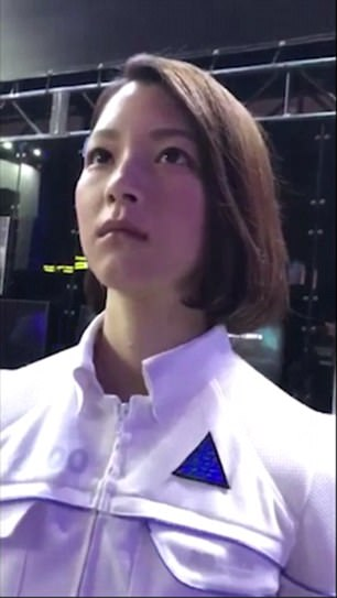 Visitors could be forgiven for thinking the alleged android was a real-life human.In the short clip, the android smiles and waves, leaving expo-goers and social media users stunned.