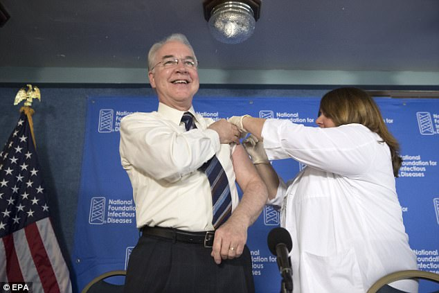 THIS MIGHT HURT A BIT: Health and Human Services (HHS) Secretary Tom Price  (L) receives a flu shot administered by registered nurse Sharon Walsh-Bonadies (R) during an event on the importance of annual influenza prevention, at the National Press Club