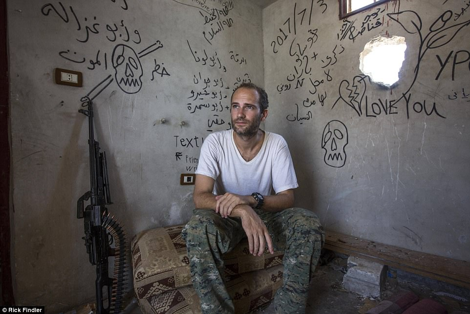 Foreign volunteer fighter Macer rests during guard duty in his front line base in the Al-Nahda neighbourhood on the front lines of Raqqa. He is determined not to leave until ISIS has been defeated