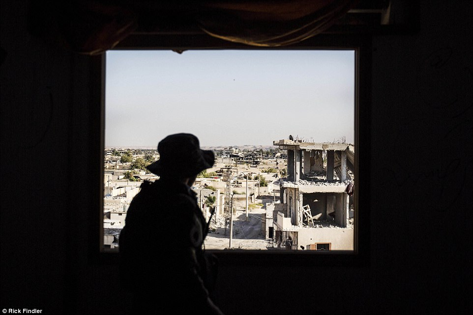 MFS soldier Sufian Alloush looks out over the city of Raqqa. Sufian was recently killed by an ISIS sniper