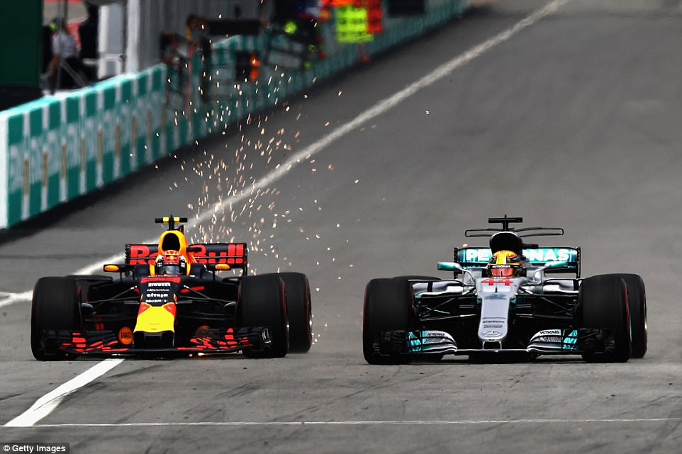 Sparks flew between Max Verstappen (L) and Lewis Hamilton as the young Dutchman stole pole from the Mercedes star