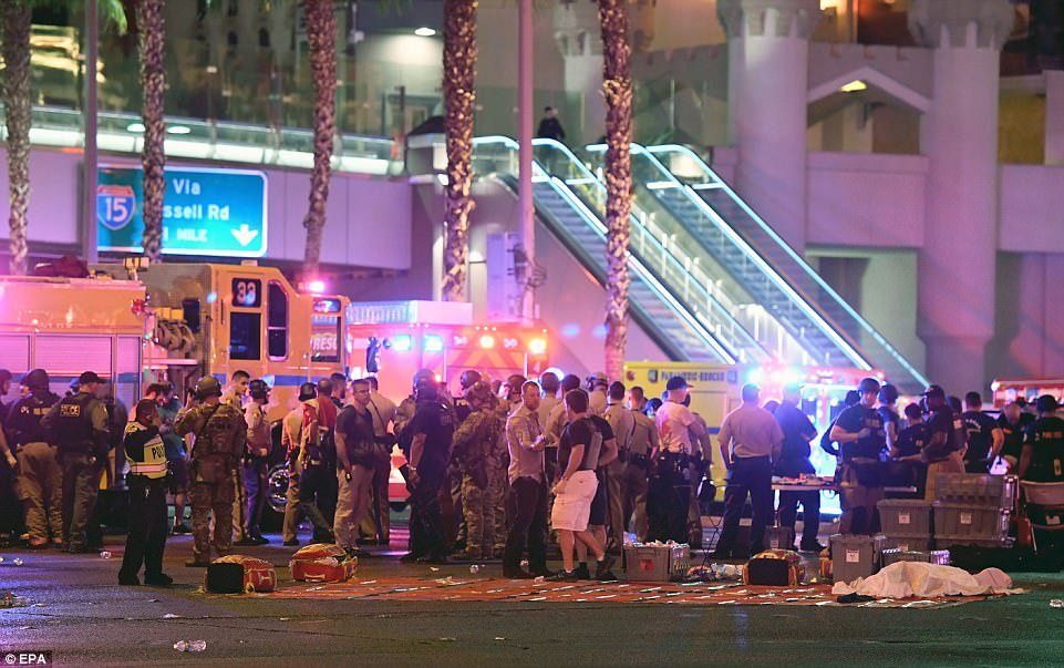 What appears to be a body under a sheet lies in front of swarms of police and rescue personnel at the intersection ofLas Vegas Boulevard and Tropicana Ave