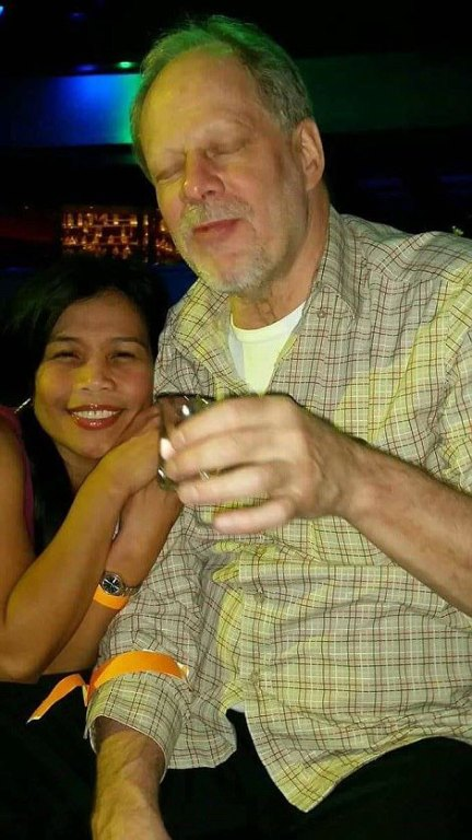 Why Paddock (pictured with girlfriend Marilou Danley, 62) shot up the crowd is unknown. He had no religious or political affiliations, no military background, and was known to have just a couple of handguns, his brother said