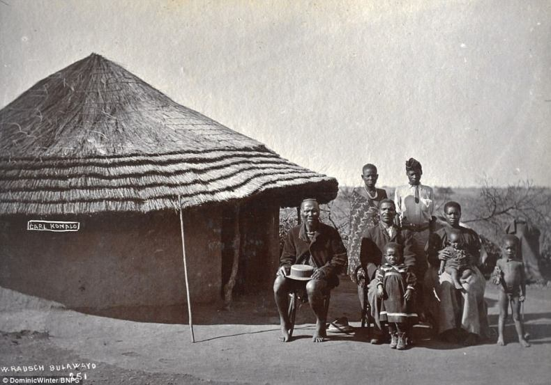 He went on:'There are are interesting photos of the native tribes and the remarkable sight of a regiment lined up on bicycles.' Pictured, a native family posing for a photograph