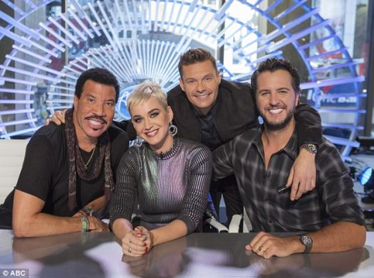 16th season premieres in March! According to TMZ, the buzzcut blonde scored a $25M paycheck to judge ABC's American Idol reboot alongside Lionel Richie (L), Luke Bryan (R), and original host Ryan Seacrest (2-R)