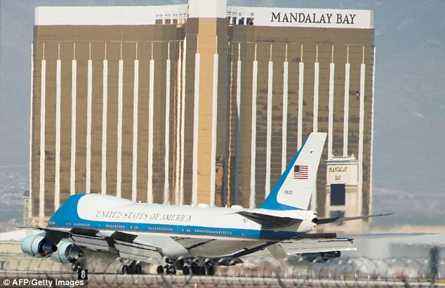 Air Force One taxied to a stop with the Mandalay Bay Resort Casino in the background - the building where mass-murderer Stephen Paddock opened fire on a coutry music festival from behind a smashed window