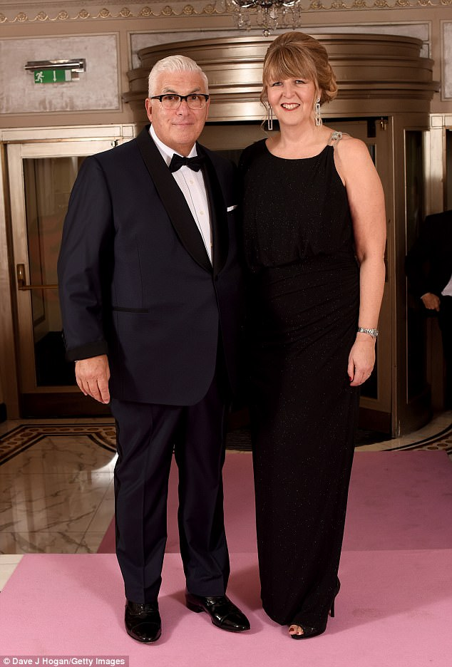 Mitch looked handsome in a navy suit with a slick black collar, while Jane went for a regal black number