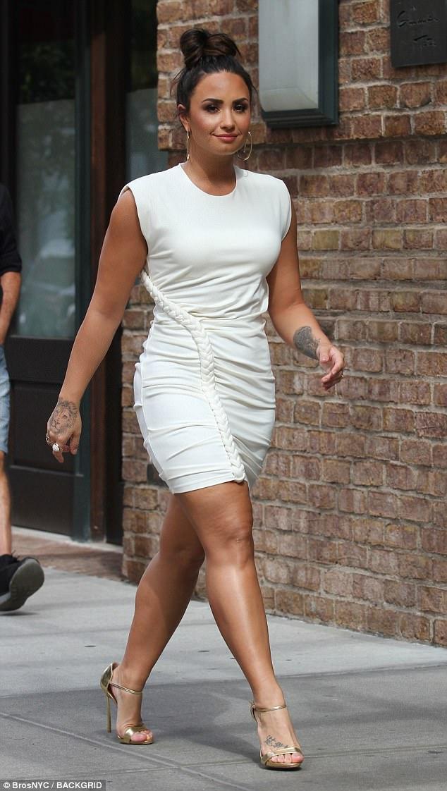 Demi Lovato Shows Off Legs In White Mini Dress In NYC