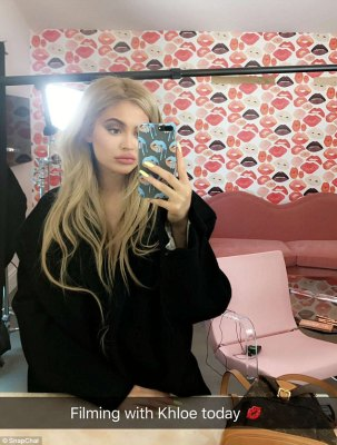 Sealed with a kiss!Before goofing around with her big sis, the Snapchat favorite shared a mirror selfie captioned: 'Filming with khlo today [lipstick emoji]'