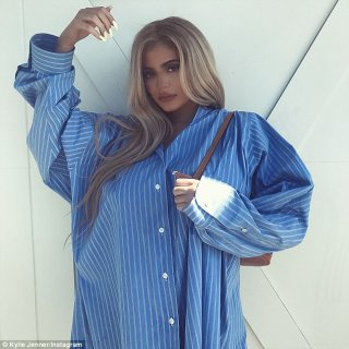 Hiding something? Later on, the Life of Kylie star donned a large blue dress shirt on Instagram, perhaps masking a growing baby bump