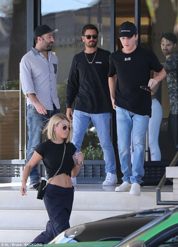 Trendsetter: As well as the knotted top, the youngest daughter of singer and songwriter Lionel Richie wore navy pants and glossy black leather shoes with a low heel