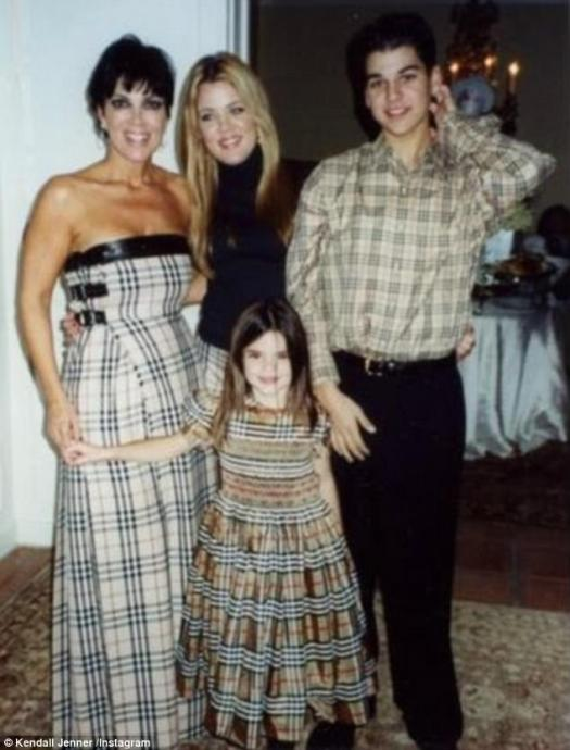 Popular choice: This pre-fame picture of one of America's most famous families, the Jenner-Kardashians (pictured left to right, Kris Jenner, Kendall Jenner and Khloe Kardashian and Rob Kardashian), shows that the look was loved by all age groups in the Noughties