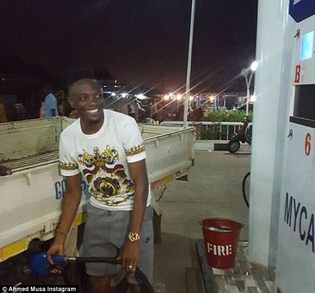 The Leicester forward looked delighted as he filled up a truck with petrol in his native Nigeria