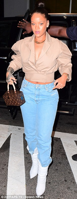 Belly dancer! The singer/designer wore high-waisted jeans to reveal just a hint of tummy