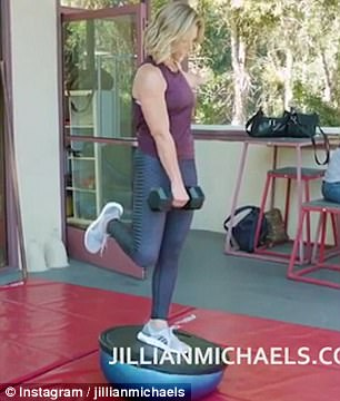 Jillian balances on a Bosu Ball