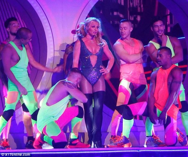 Performer: The mother-of-one changed into a slinky bodysuit and thigh-high stockings and boots