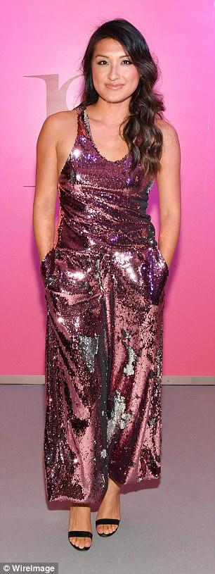 Brunettes collide!Krystal Koo shimmered in a metallic pink jumpsuit