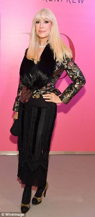 All that glitters! Lynda Prince slipped into a gold embellished satin blazer and faux fur
