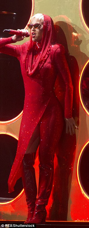 Katy in red: The singer was seen belting her hits out for her latest stage performance on Thursday
