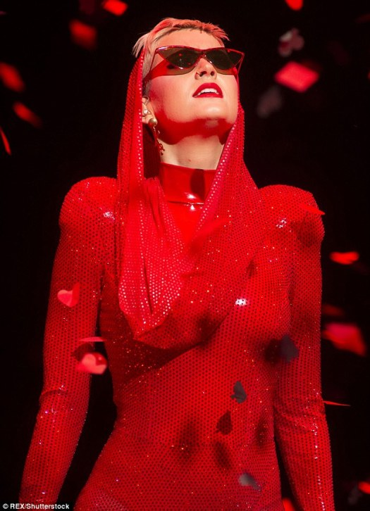 Sparkly: She wore a ruby red  shimmering ensemble for the performance