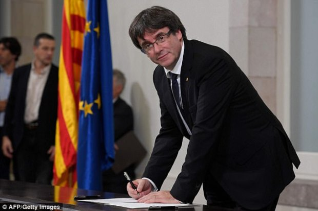 Pull off the band-aid: Allies of Catalan president Carles Puigdemont has today called on him to ignore the Spanish government's threats to take control of Catalonia's regional government