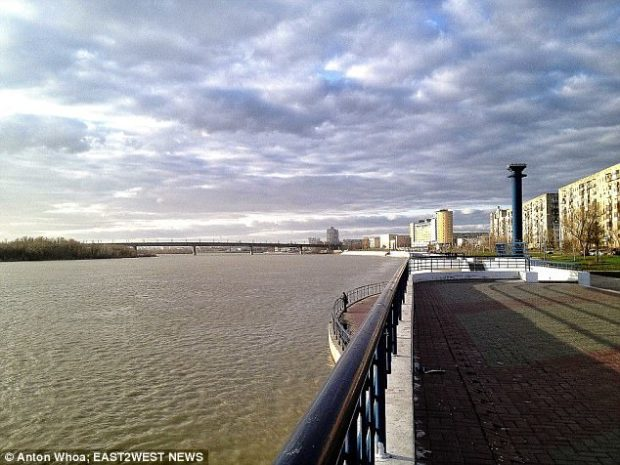 After the assault the woman went to the bridge and sat on edge, but was talked down by a passing taxi driver. Pictured the bridge inOmsk