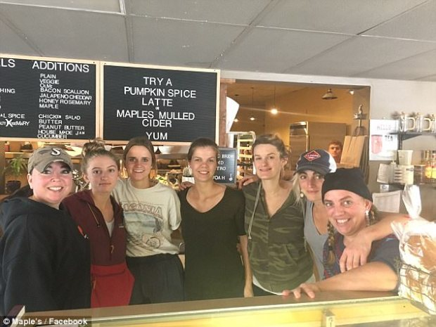Staff pose for a photo after an anonymous customer purchased meals for fellow customers as a means to honor victims of the Las Vegas massacre