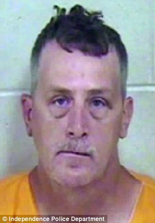 Russell L. Burd, 45, allegedly handcuffed a woman in her home, raped her with her three-year-old son in another room, and then asked her to delay calling the police so that he could ¿down a couple of beers¿ before going to jail