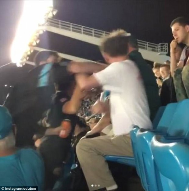 The man on the left continued to punch the older man a handful of times before bystanders broke up the fight