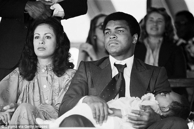 Khalila Ali was incensed that her husband introduced Porche as his wife just before the historic Thrilla in Manila heavyweight bout in 1975. The couple is seen above with their daughter, Hana, in this undated file photo