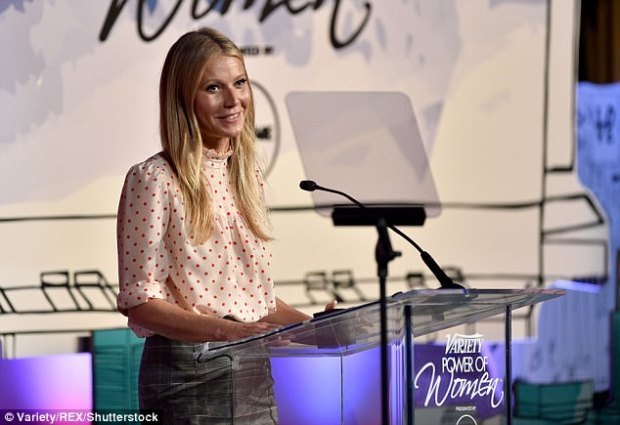 Working it: For the event Gwyneth, 45, looked businesslike but chic a polka dot long-sleeved blouse and grey pencil skirt