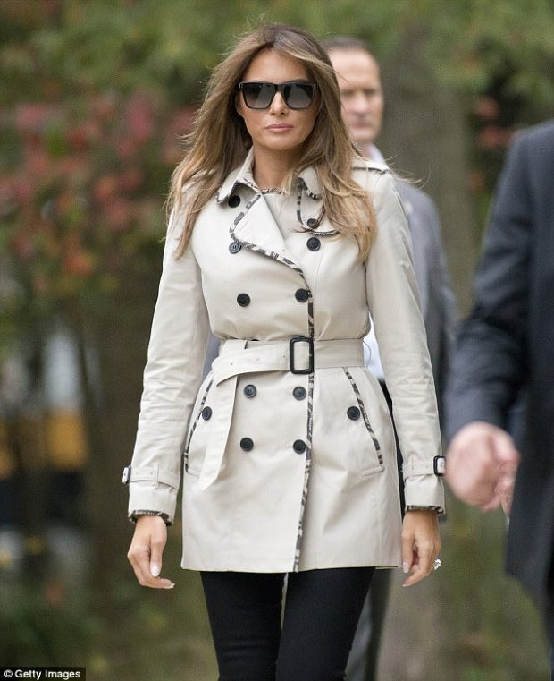 Classic: Melania Trump wore aa Burberry trench coat with a check woven trim on Thursday
