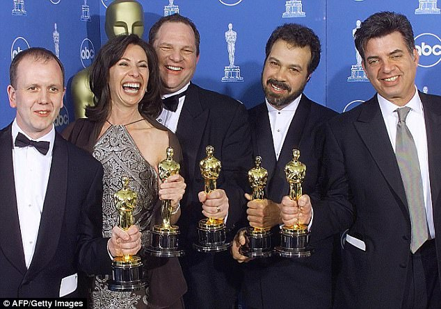 Winners of the Oscar for Best Picture, Shakespeare in Love,  pose for photographers. From left are:  David Parfitt, Dianna Gigliotti, Harvey Weinstein, Edward Zwick, and Marc Morman