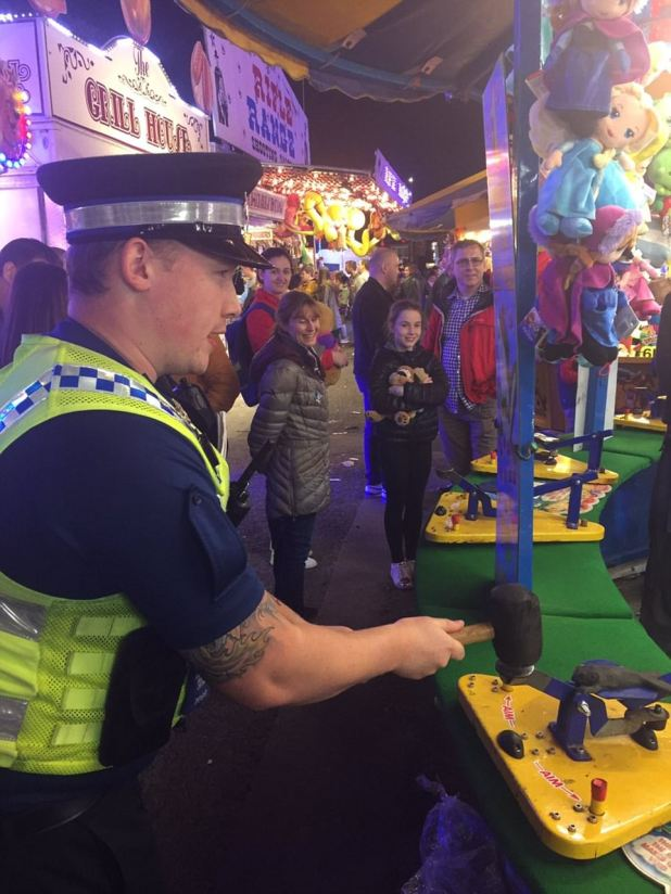 The policemen and women were spotted playing on other fairground amusements, taking to Twitter to praise 'a fantastic afternoon at the fair'