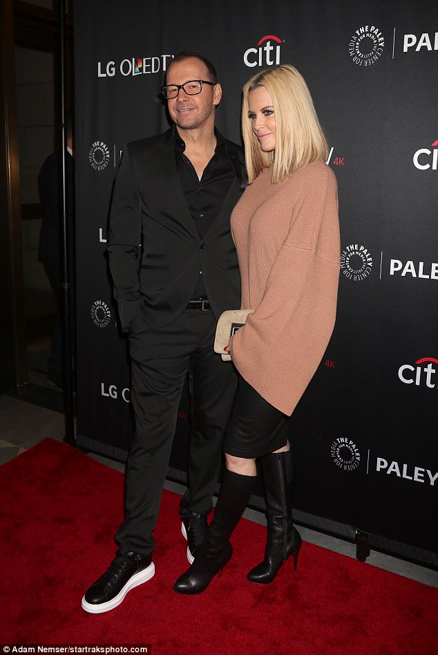 Smart couple:The 48-year-old looked sharp in all black as his 44-year-old wife sported leather boots and a black skirt