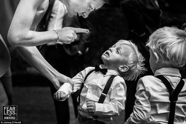 Trouble: Joshua D'Hondt of Antwerp, Belgium, photographed the priceless expression on a little boy's face while getting scolded by his finger-wagging mother