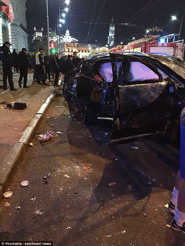 Alyona Zaitseva's armed bodyguards drove up in two jeeps immediately after the crash and protected her from a furious crowd who witnessed the crash