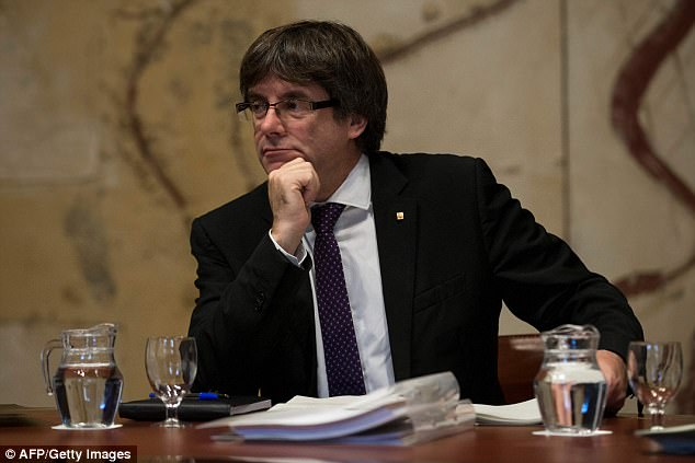 Spanish authorities are preparing to arrest Catalonia's president Carles Puigdemont and charge him with rebellion if he declares independence