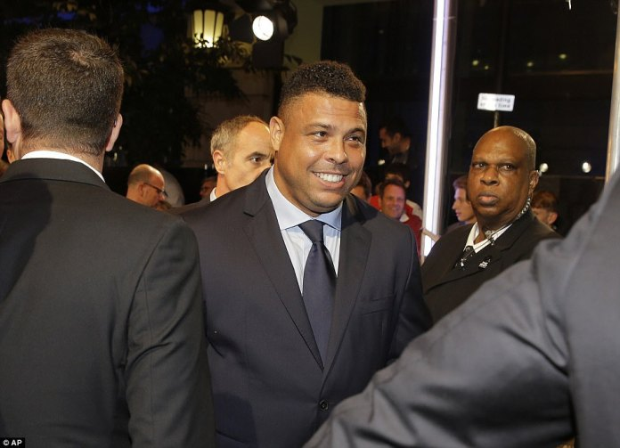 Brazil legend Ronaldo was in a joyful mood as he is guided into the awards ceremony at the London Palladium