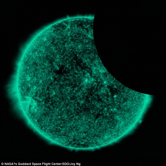 The lunar transit occurred between 3:41 and 4:25 p.m. EDT according to NASA. At its peak, the moon covered roughly 26 percent of the sun