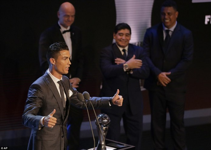 He was presented with the award in London by (left to right) FIFA president Gianni Infantino, Diego Maradona and Ronaldo
